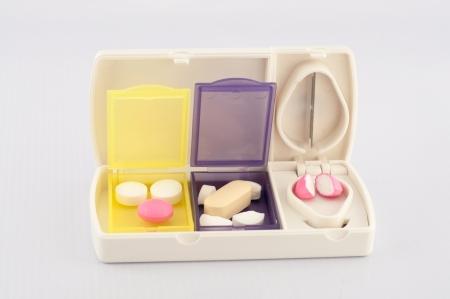 pill box: Pill box and split blade tablet show medicine concept