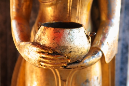 Closed up Buddha and bowl at Doi Suthep in Chiangmai Thailand photo