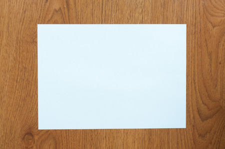 White paper on table wood photo