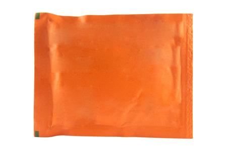 bolsita: Bolsita naranja sobre fondo blanco Foto de archivo