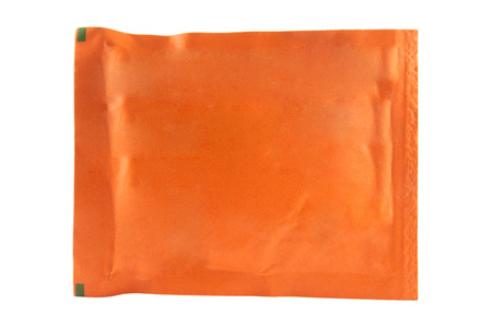 Orange sachet on white background photo