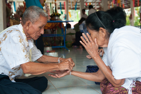rite: Nongkhai, THAILAND - OCTOBER 08 : Bind the holy thread in Thai rite on Oct 08, 2014 in Nongkhai province, Thailand.