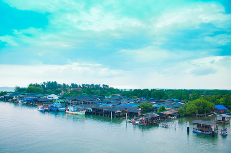 relate: RAYONG , THAILAND- OCTOBER 18 2014 : Habitation of fisherman at relate of Prasae river. Rayong province, Thailand.