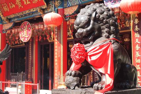 sin: HONG KONG - January 19, 2015 - Lion statue in Wong Tai Sin temple on January 19, 2015, in Hong Kong.