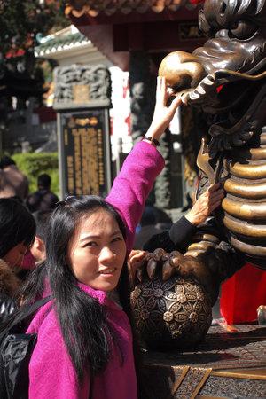 sin: HONG KONG - January 19, 2015 - dragon statue in Wong Tai Sin temple on January 19, 2015, in Hong Kong.