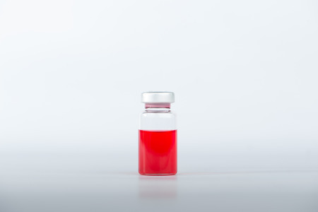 vial: Red liquid in injection vial Stock Photo