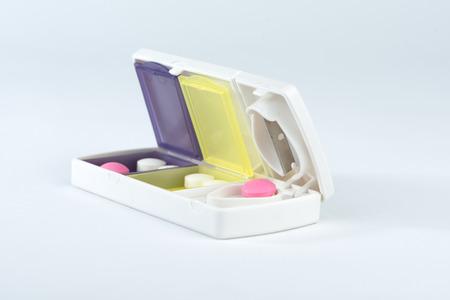 pill box: Pill box and aluminum split blade show medicine concept