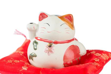 maneki: Maneki Neko cat on red pillow