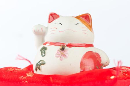 neko: Maneki Neko cat on red pillow
