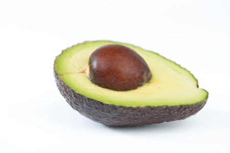 Closed up cut of half avocado fruit on white Stock Photo