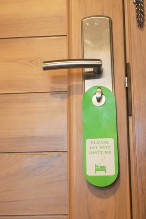 Do not disturb sign hang on door photo