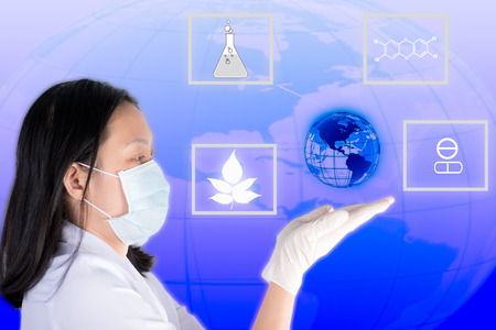 glowing earth: Technician hold and look glowing earth show medicine discover process