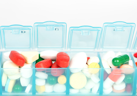 pill box: Closed up Medicine tablet  in weekly pill box