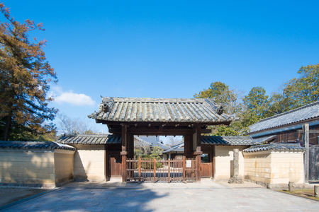 Traditional Japaness gate at Nara garden.This is an Unesco World Heritage site. Editorial