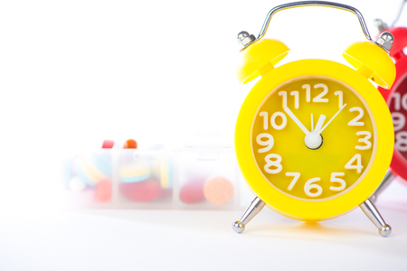 Alarm clock and pill box show medicine time