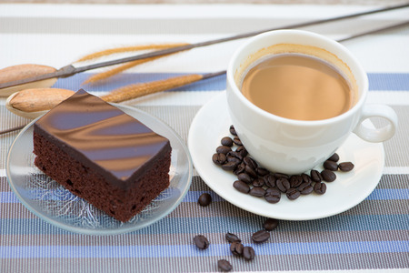 A cup of coffee and Chocolate cake