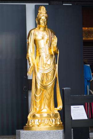 Kamakura, Japan - November 07, 2018:Gold Kannon at Kannon museum in Haze-dera temple or Hase-kannon temple in Kamakura,Japan Standard-Bild - 115465744