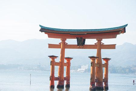 """Floating torii gate of Itsukushima Shrine at Miyajima island Hiroshima, Japan. Japanese characters mean """"itsukushima shrine"""""""