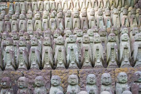 Buddha statues praying at the Hase-Dera temple in Kamakura, Japan