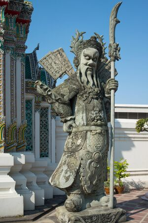 Chinese Warrior Sculpture in The Phra Chettuphon Wimon Mangkhalaram (Wat pho), Bangkok, Thailand 写真素材
