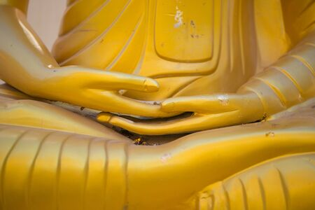 Closed up hand of Gold Buddha in Wat Phra That Bang Phuan in Nongkhai of Thailand