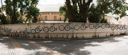 decorated bike: Panorama wall decorated with bycicles Stock Photo