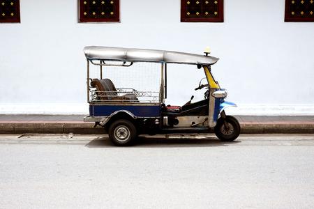 three wheels taxi name tuk tuk ,famous in bangkok thailand