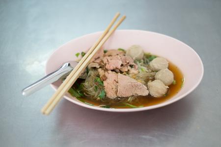 Bangkok street food ,noodle with beef and meatball , shoot selective focus Reklamní fotografie