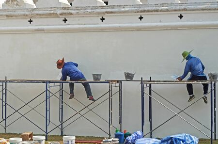 asian worker paint the wall