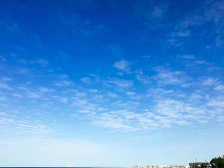 Deep Oman beach sky overcasted with clouds, blue sky with fainted and dispersed clouds