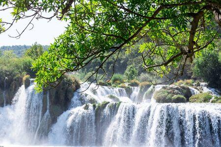 Breathtaking view Waterfalls of Krka National Park, Sunny day, summer season having greenery and trees, Croatia
