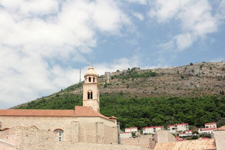 Ancient church top view, and stairs of Dubrovnik old town, hand made walls build with old bricks and stones, clock tower, bell tower, Croatia