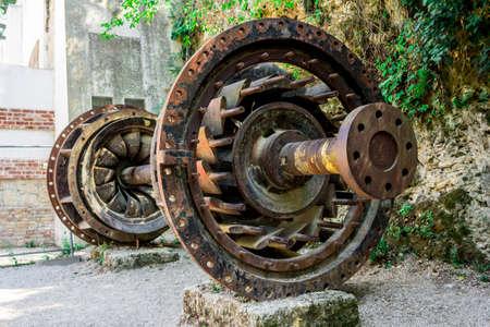 Old dam turbine blade on the outdoor museum rusting, Krka National Park, Croatia