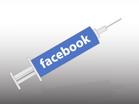 the facebook logo in the syringe Stock Photo - 11652216