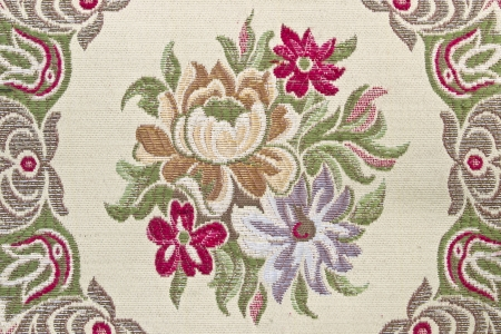 fabric background with the embroidered flowers photo