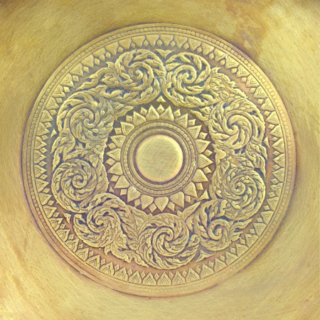 or rust: Thai pattern on old brass plate Stock Photo