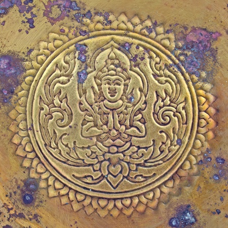 Thai pattern on old brass plate photo