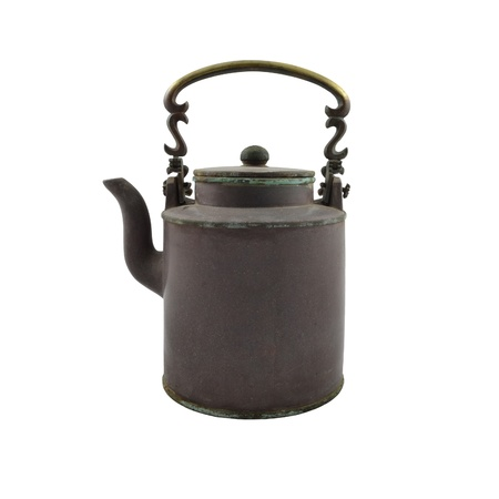 antique brass kettle on a white background photo