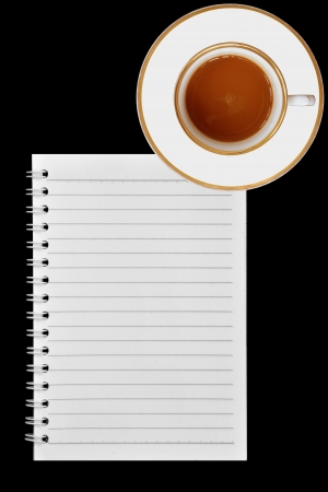 notebook and cup of coffee on black background photo
