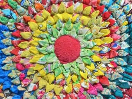 closeup of doormat made from scrap fabric photo