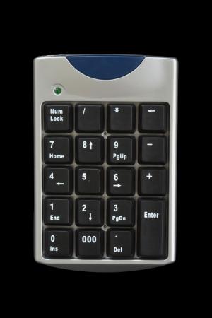 teclado numerico: computadora teclado numérico sobre fondo negro
