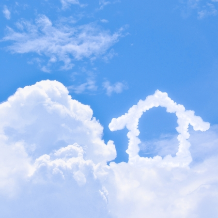 Clouds shaped house on the blue sky