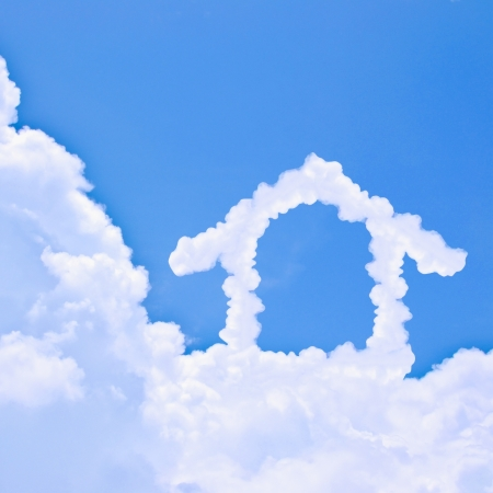 Clouds shaped house on the blue sky photo