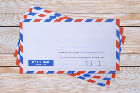 mail envelope on wooden background photo