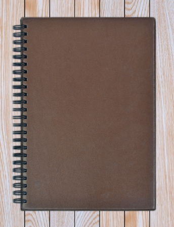 leather notebook on a wooden background photo