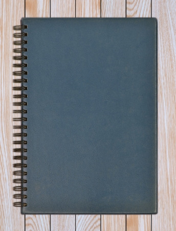 leather notebook on a wooden background
