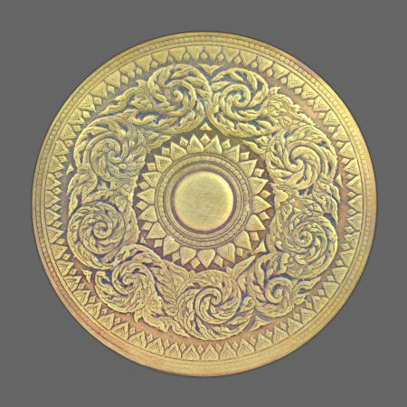 Thai pattern on old brass plate Stock Photo