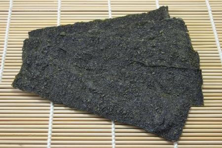 fried seaweed on bamboo mat