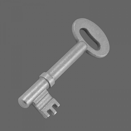 key on a gray background Stock Photo