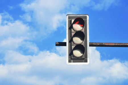 stop and go light: closeup of traffic light with blue sky